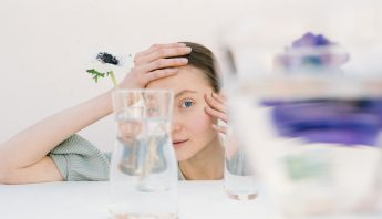 A woman with Autism looks through glass