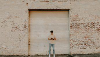 A teen checks social media on his phone